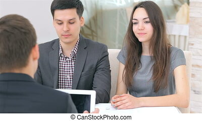 Young attractive couple consults about their business project