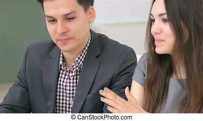 Young attractive couple discuss about their business project
