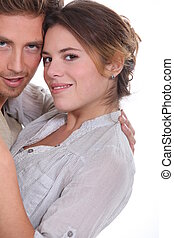 young attractive couple hugging