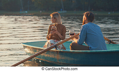 Young attractive couple in a boat