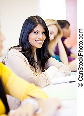 young attractive female college students in classroom