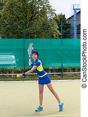Young attractive female tennis player during a game
