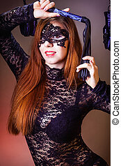 Young attractive girl in bra and lace underwear.  The concept of BDSM and bondage.