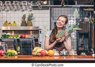 Young attractive girl with a pineapple