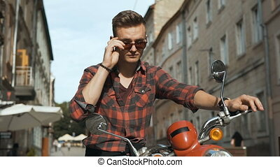 Young Attractive Hipster on Motorbike - Young attractive man...