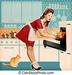 Young attractive housewife cooking in an oven Retro kitchen ...