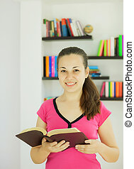 Young attractive lady with a book