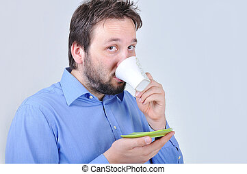 Young attractive man is drinking a cup of coffey