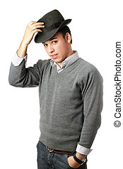 Young attractive man wearing black hat. Isolated