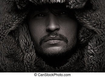 Young attractive man wearing fur