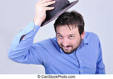 Young attractive man with blue shirt and the hat