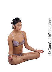 Young attractive Pacific Islander Woman lotus position