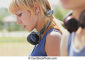 Young attractive punk girl with wireless headphones