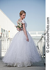 young attractive twenties caucasian bride in outdoor setting