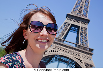 Young attractive woman against Eiffel Tower, Paris, France -...