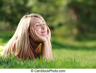 day dreaming - young attractive woman at the park day ...