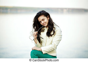 Young attractive woman brunette smiling outdoors