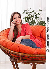 Young attractive woman calling by phone
