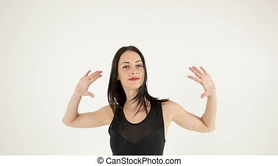 attractive woman dancing and looking at camera