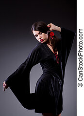 Young attractive woman dancing flamenco