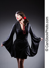 Young attractive woman dancing flamenco