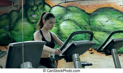 Young attractive woman enhancing her endurance while working...