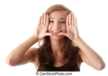 Young attractive woman framing her face