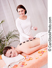 young attractive woman get hot stone massage