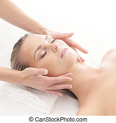 Young attractive woman getting spa treatment over white ...
