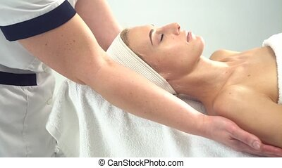 Young attractive woman getting spa treatment over white background
