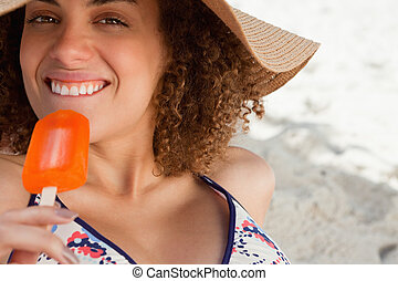 Young attractive woman going to eat a delicious ice cream on the beach