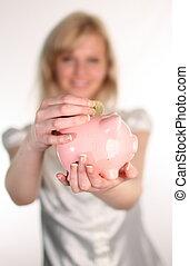 Woman Holding a piggybank