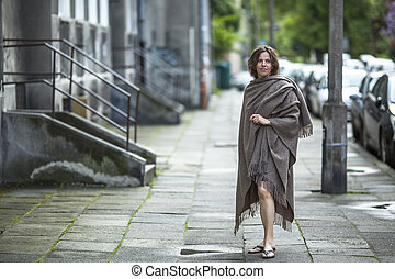 woman in a poncho standing