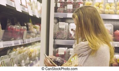 Young attractive woman in a supermarket