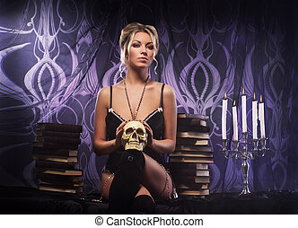 Young attractive woman in sexy lingerie posing in gothic interior