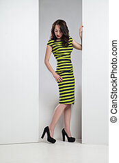 Young attractive woman in striped dress