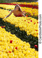 young attractive woman in tulip field