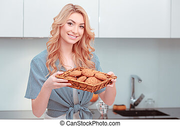 Young attractive woman making home pastry