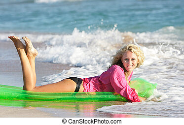 young attractive woman on beach
