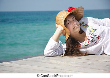 young attractive woman on sea background