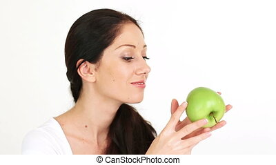 Young attractive woman playing with green apple