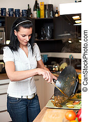 Young attractive woman preparing lunch
