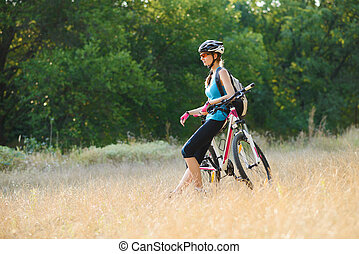 Young Attractive Woman Resting with Bike on the Beautiful...