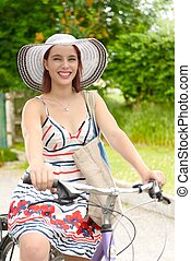 Young attractive woman riding a bicycle