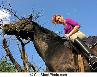 young  attractive  woman riding in wild nature