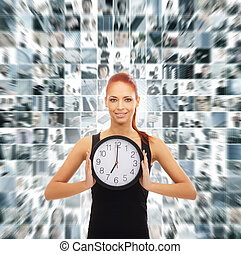 Young attractive woman showing the clock isolated on white