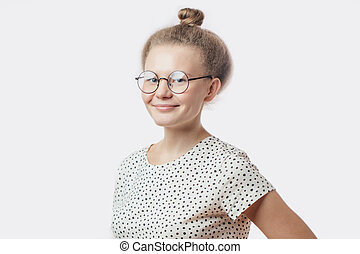 young attractive woman wearing bun posing to camera