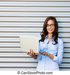 Young attractive woman wearing glasses with laptop
