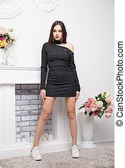 Young attractive woman wearing in knitted dress