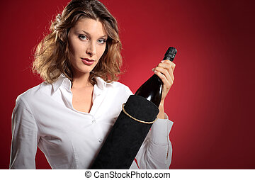 young attractive woman with a bottle of sparkling wine, gift box